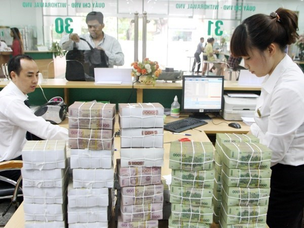 Reference exchange rate goes down by 4 VND hinh anh 1