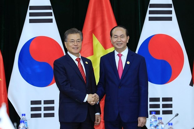 APEC 2017: President Tran Dai Quang meets with RoK President hinh anh 1