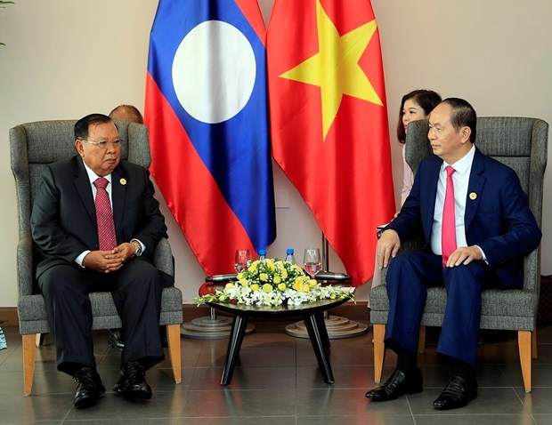 APEC 2017: Vietnamese President meets with top leader of Laos hinh anh 1