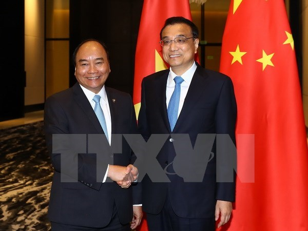 Vietnamese, Chinese prime ministers hold meeting in Manila hinh anh 1