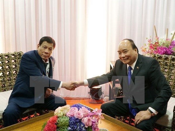 PM meets Russian, Philippine leaders at ASEAN Summit hinh anh 1