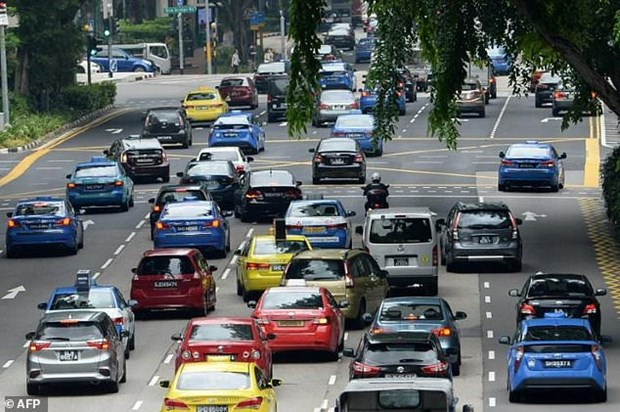 Singapore rolls out tough measures to reduce cars hinh anh 1