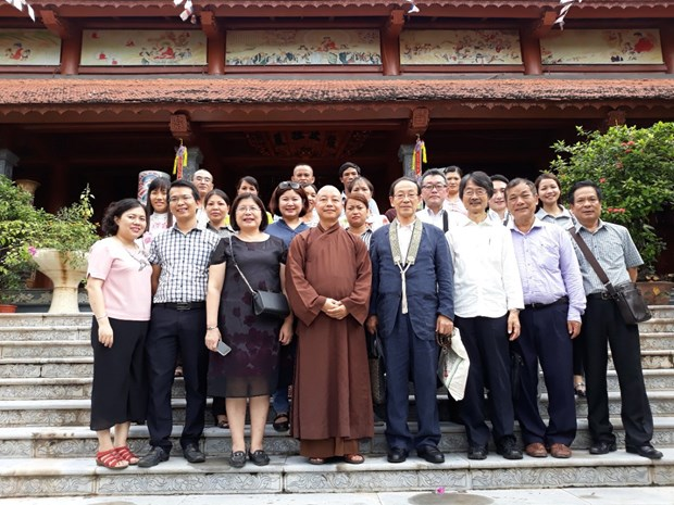 Buddhist followers join hands in ensuring social welfare hinh anh 4