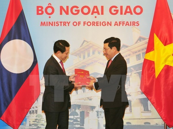 Vietnam-Laos ministerial-level consultation held in Hanoi hinh anh 1