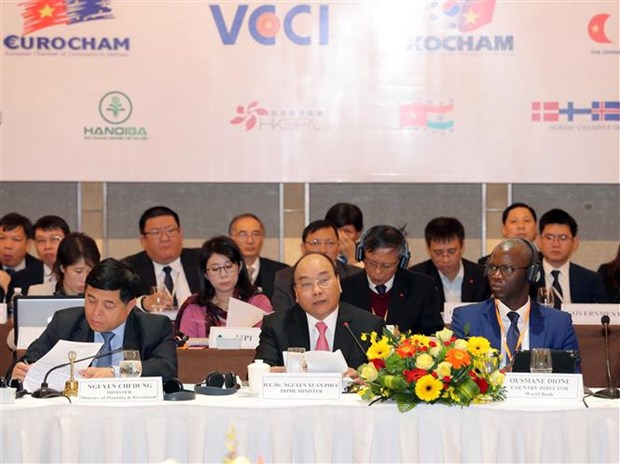 PM acknowledges business contributions to Vietnam economy hinh anh 1