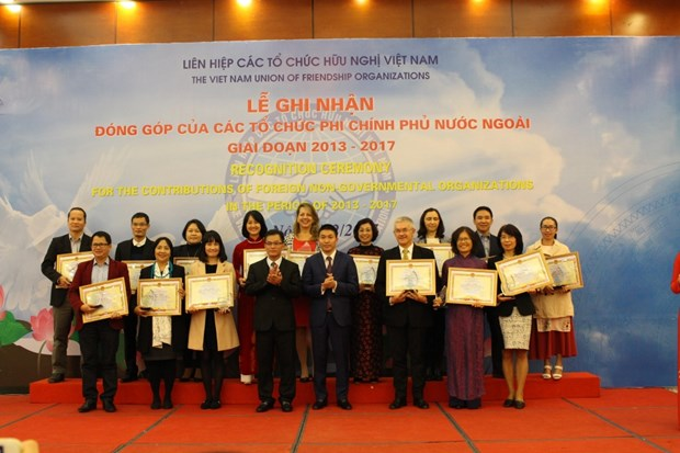 NGOs honoured for contributions to Vietnam's poverty reduction hinh anh 1