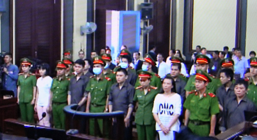 Trial opens on airport bombing suspects hinh anh 1