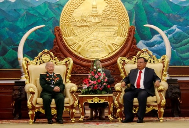 Lao Party chief lauds dedication of Vietnamese volunteer soldiers hinh anh 1