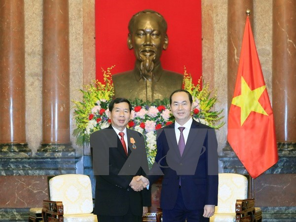 President Tran Dai Quang receives Lao supreme court chief hinh anh 1