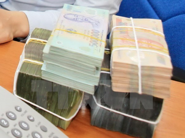 Reference exchange rate revised down on Jan 8 hinh anh 1