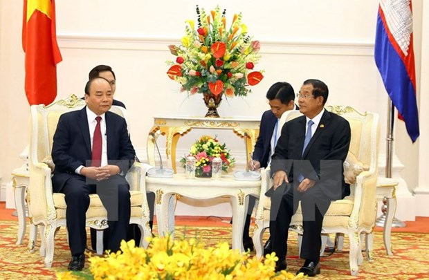 PM affirms policy on strengthening ties with Cambodia hinh anh 1