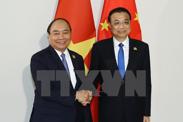 PM meets Chinese counterpart in Phnom Penh hinh anh 1
