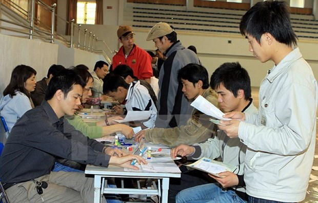 Vietnamese workers in Thailand allowed to get work permits hinh anh 1
