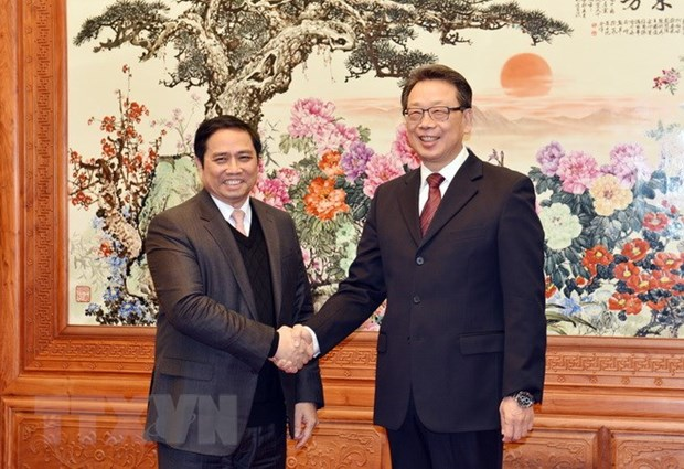 Party delegation pays working visit to China hinh anh 1