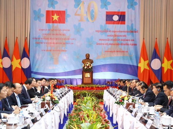 Vietnamese, Lao PMs co-chair Inter-Governmental committee meeting hinh anh 1