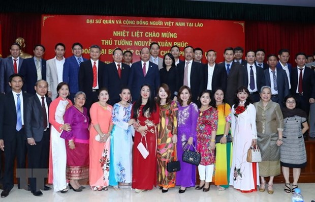 Vietnamese, Lao PMs join traditional Tet celebration in Vientiane hinh anh 1