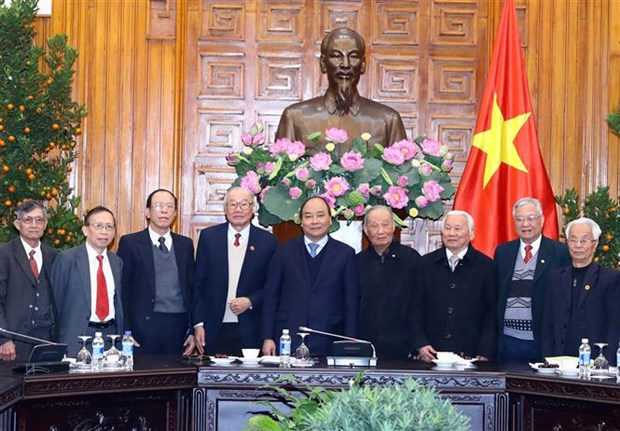 PM meets Vietnamese contributors to Cambodian revolution hinh anh 1