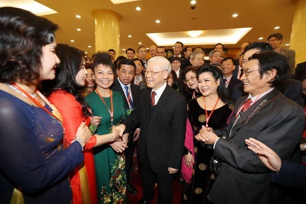 Party chief welcomes overseas Vietnamese home for Tet hinh anh 1