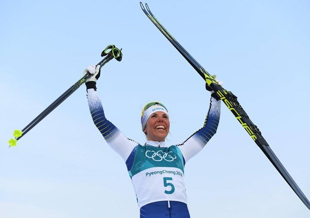 Swedish cross-country skier wins PyeongChang 2018's first gold medal hinh anh 1
