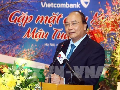 PM lauds Vietinbank, Vietcombank's business results last year hinh anh 1