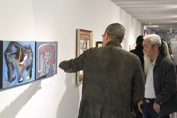 Hanoi: Dog paintings show celebrates Year of the Dog hinh anh 1