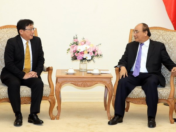 Prime Minister pledges favorable conditions for Japanese groups hinh anh 1