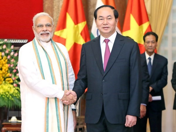 President Tran Dai Quang and spouse leave for India hinh anh 1