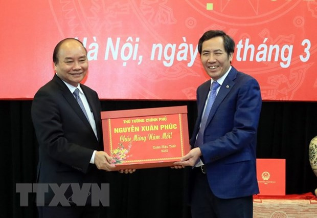 PM holds working session with Nhan dan newspaper hinh anh 1