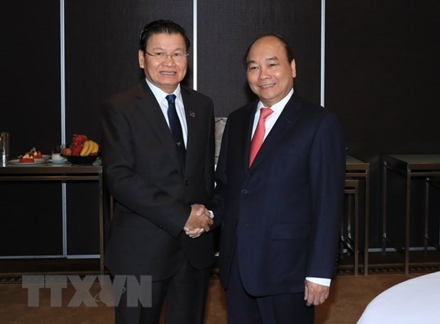 Vietnamese, Lao PMs meet on ASEAN-Australia Special Summit sidelines hinh anh 1