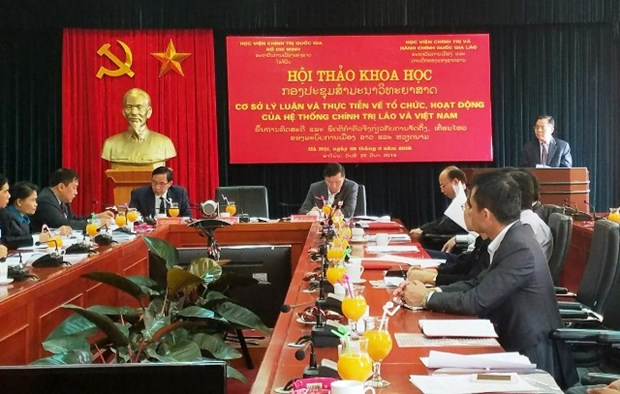 Vietnam, Laos exchange experience in political system operation hinh anh 1