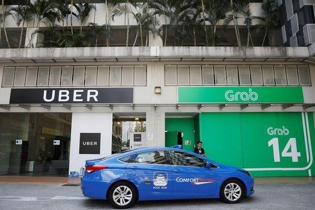 Singapore investigates Grab-Uber merger hinh anh 1