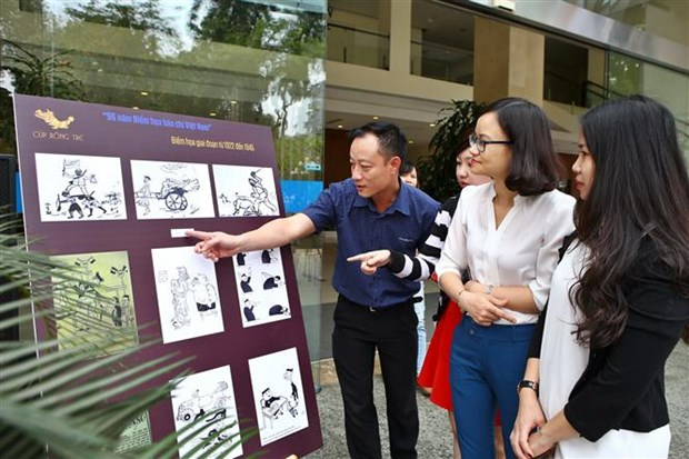 Vietnam press caricature contest returns after four years hinh anh 1