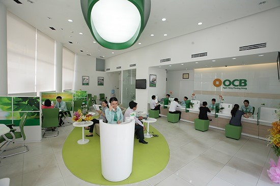 Vietcombank sells out OCB stake at auction hinh anh 1