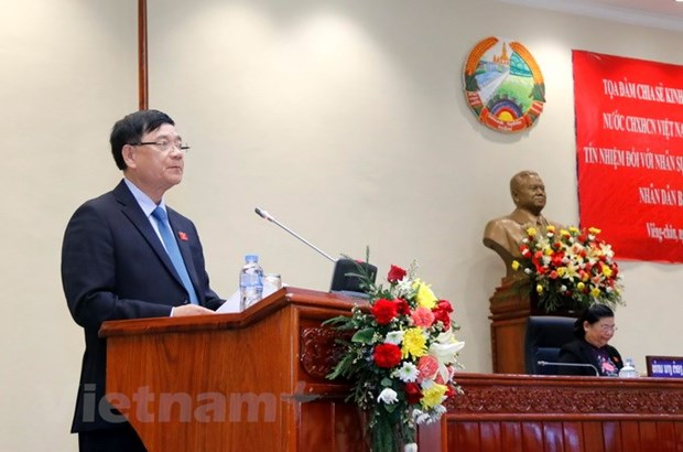 Vietnam share experiences in taking votes of confidence with Laos hinh anh 2