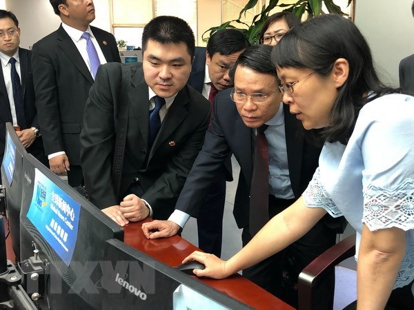 Vietnam News Agency leader active in China hinh anh 1