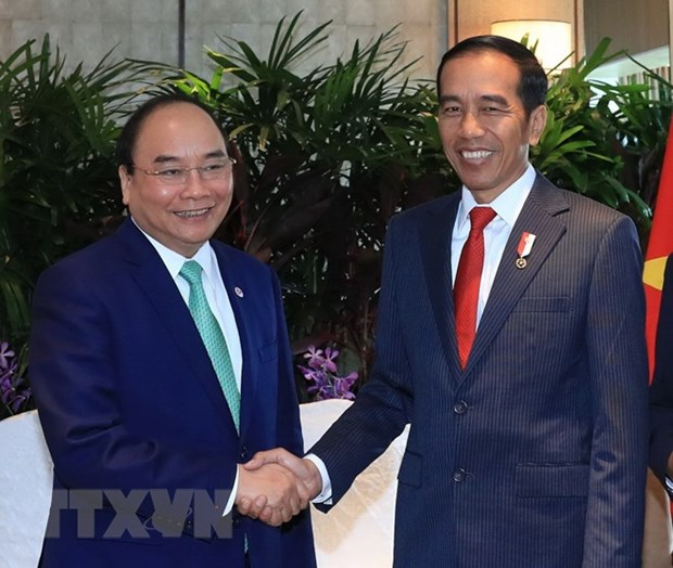 PM Nguyen Xuan Phuc held bilateral meetings on sidelines of ASEAN Summit hinh anh 1
