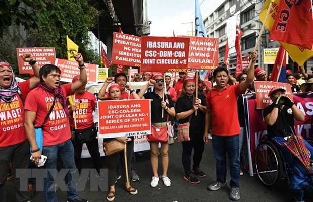 Philippine workers march to call for labour issue settlement hinh anh 1