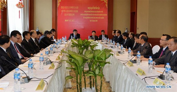 China, Laos to strengthen fight against cross-border crimes hinh anh 1