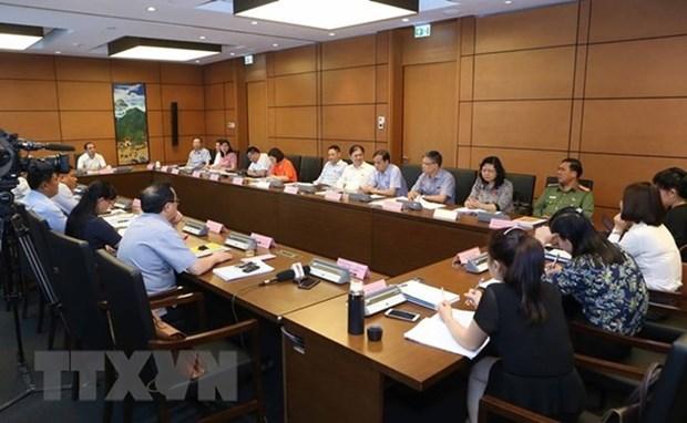 Legislators debate draft laws on May 23 hinh anh 1