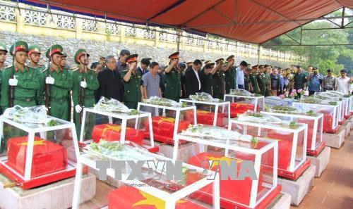 Reburial service held for soldier remains repatriated from Laos, Cambodia hinh anh 1