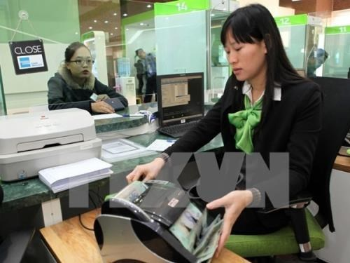Reference exchange rate stays flat on June 19 hinh anh 1