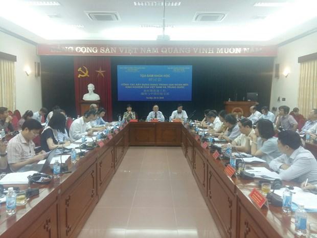 Int'l seminar highlights Party building experience of Vietnam, China hinh anh 1