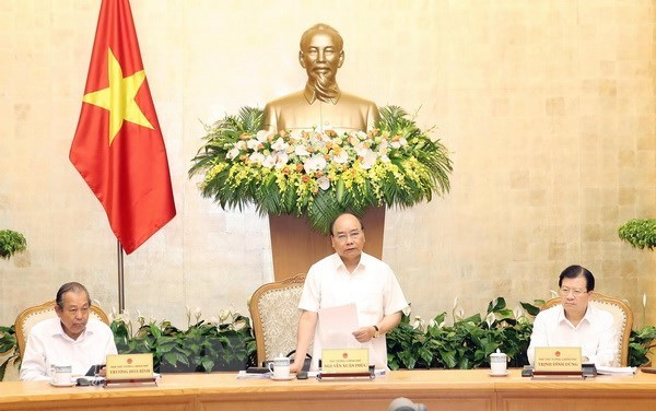 PM Nguyen Xuan Phuc asks for greater focus on building institutions hinh anh 1