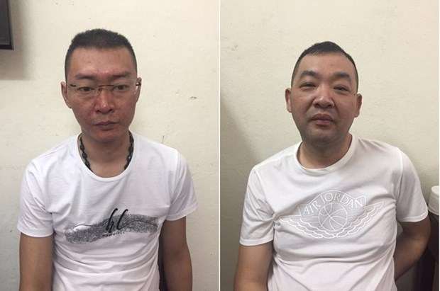 Vietnam hands over two wanted men to China hinh anh 1