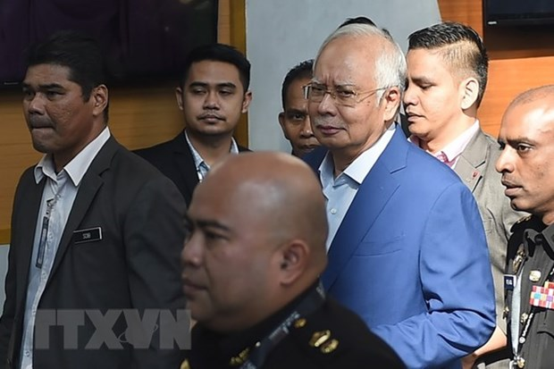 Former Malaysian PM brought to court over corruption scandal hinh anh 1