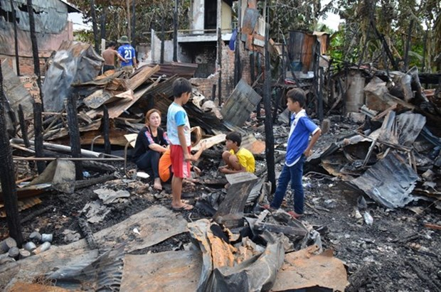 Normal life returns to Vietnamese Cambodians affected by blaze hinh anh 1