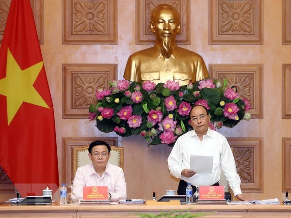 Vietnam seeks experts' comments to perfect monetary policy: PM hinh anh 1