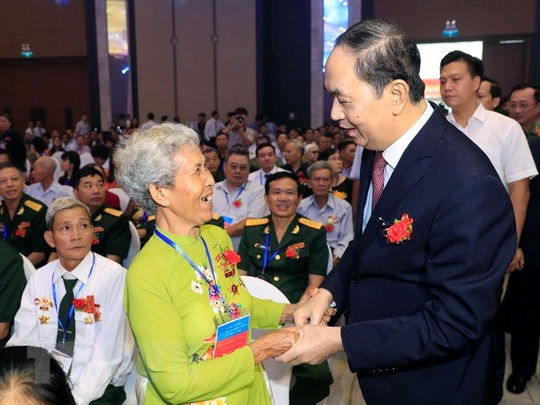 State pays special attention to caring for revolution contributors: President hinh anh 1
