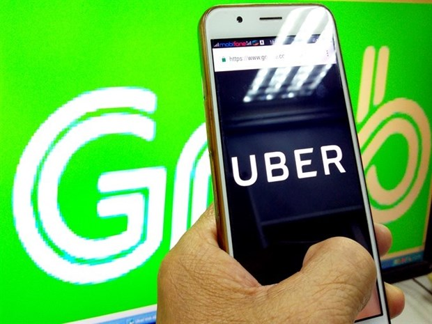 Local ride-hailing apps struggle to compete with Grab hinh anh 1