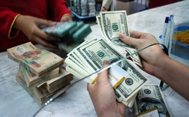 VN currency suffers from US-China trade war hinh anh 1